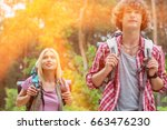 young hiking couple looking... | Shutterstock . vector #663476230