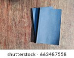 a book on a vintage wood table... | Shutterstock . vector #663487558