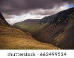 a moody sky over honister pass | Shutterstock . vector #663499534