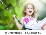 child on swing. | Shutterstock . vector #663500560