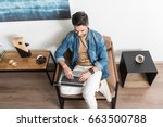 happy youthful guy working on... | Shutterstock . vector #663500788