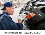 sports car in a workshop | Shutterstock . vector #663504160