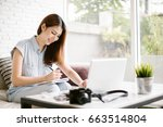 asia woman using laptop and... | Shutterstock . vector #663514804
