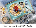 oat flakes in a bowl with... | Shutterstock . vector #663515404