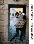 street musician playing tuba... | Shutterstock . vector #663525580