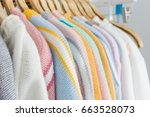 colorful clothes hang on shelf... | Shutterstock . vector #663528073