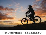 silhouette of a cyclist rider... | Shutterstock . vector #663536650