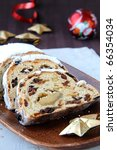fruitcake for Christmas on a wooden board - stock photo