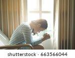 asian woman praying morning... | Shutterstock . vector #663566044