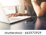 woman working on laptop... | Shutterstock . vector #663572929