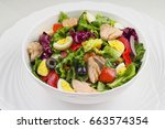 salad with fish and vegetables | Shutterstock . vector #663574354