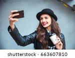 happy young woman taking selfie.... | Shutterstock . vector #663607810