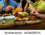 people eating burger in a... | Shutterstock . vector #663608914