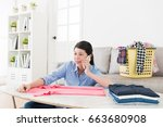 smiling pretty mother using... | Shutterstock . vector #663680908