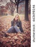 young blonde woman enjoying... | Shutterstock . vector #663698146