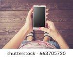 woman holding modern smart...   Shutterstock . vector #663705730