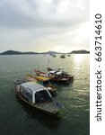 Small photo of fishing boats with roof rack or truck roof at Sattahip Thailand , Gulf of Thailand