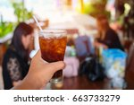 close up  hand holding glass of ... | Shutterstock . vector #663733279
