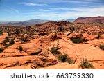 red rock arid landscape of snow ... | Shutterstock . vector #663739330