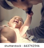 father is taking care of his... | Shutterstock . vector #663742546