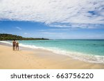 vacation couple walking on... | Shutterstock . vector #663756220