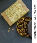 an elegant golden gift box and... | Shutterstock . vector #663759529