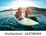 couple of surfers waits the... | Shutterstock . vector #663780484