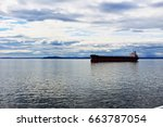 cargo sails in the ocean. boat... | Shutterstock . vector #663787054