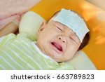 the baby is feverish and crying.... | Shutterstock . vector #663789823