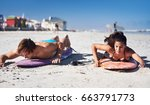couple learning how to surf ... | Shutterstock . vector #663791773