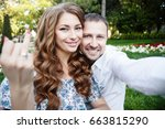 young couple taking a selfie... | Shutterstock . vector #663815290