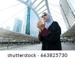 muslim woman praying in public  ... | Shutterstock . vector #663825730