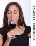 beautiful woman in black dress... | Shutterstock . vector #66385429