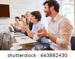 start up team giving applause... | Shutterstock . vector #663882430