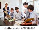 start up team discussing and... | Shutterstock . vector #663882460