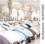 praying together | Shutterstock . vector #663901003