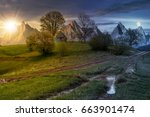 day and night time change concept; woodshed among trees on a hill by the road.  Composite High Tatras countryside landscape in dramatic weather with sun and moon - stock photo