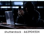 hacker using a smartphone. very ... | Shutterstock . vector #663904504