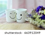 two happy cups with dries... | Shutterstock . vector #663912049