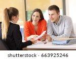 two happy customers solving... | Shutterstock . vector #663925246