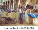 cowgirls working at a horse... | Shutterstock . vector #663944089