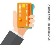 hand holding a credit card. | Shutterstock .eps vector #663950050