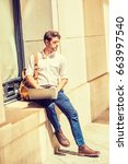 young american man studying in... | Shutterstock . vector #663997540