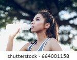 women drinking water on the park | Shutterstock . vector #664001158