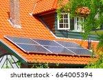 solar energy system on roof of... | Shutterstock . vector #664005394