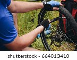 the man is repairing a bicycle... | Shutterstock . vector #664013410