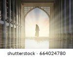 muslim woman silhouette prayer... | Shutterstock . vector #664024780