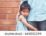 sad asian kid girl hugging her...   Shutterstock . vector #664031194