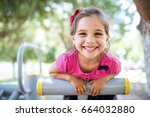 little girl playing at... | Shutterstock . vector #664032880
