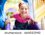Little Girl Playing At Playground Outdoors In Summer - stock photo